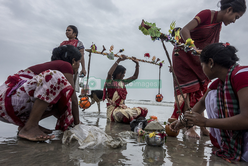 KOLKATA, Aug. 9, 2016 (Xinhua) -- Indian Hindu devotees perform rituals before offering prayers to Lord Shiva, Hindu god of destruction, during Shravan festivities at the confluence of the River Ganges and the Bay of Bengal, some 150 km south of Calcutta, capital of eastern Indian state West Bengal, Aug. 8, 2016. (Xinhua/Tumpa Mondal) .****Authorized by ytfs* (Credit Image: © Tumpa Mondal/Xinhua via ZUMA Wire)