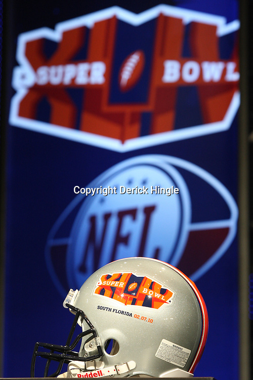 Feb 05, 2010;  Fort Lauderdale, FL, USA; A helmet on display for press conferences featuring the Super Bowl XLIV logo at the Super Bowl XLIV media center at the Fort Lauderdale/Broward County Convention Center. Mandatory Credit: Derick E. Hingle