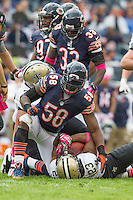 06 October 2013: Linebacker (58) D.J. Williams of the Chicago Bears raises up after tackling (23) Pierre Thomas of the New Orleans Saints during the second half of the Saints 26-18 victory over the Bears in an NFL Game at Soldier Field in Chicago, IL.