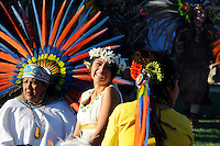 """Josselyn Melanie Cuauhyolotzin, center, during her coming-of-age ceremony on February 9th. In a colorful indigenous ritual celebrated in Salinas, Aztec teachers, dancers, family and friends gathered together to perform an Aztec """"xilonen"""" ritual for Cuauhyolotzin at the home of her parents. The elaborate ceremony marks the transition from childhood to maidenhood, and is the spiritual basis in Mexican tradition for the """"quinceanera."""""""