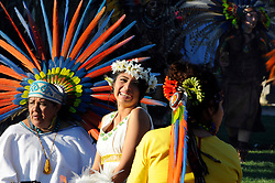 "Josselyn Melanie Cuauhyolotzin, center, during her coming-of-age ceremony on February 9th. In a colorful indigenous ritual celebrated in Salinas, Aztec teachers, dancers, family and friends gathered together to perform an Aztec ""xilonen"" ritual for Cuauhyolotzin at the home of her parents. The elaborate ceremony marks the transition from childhood to maidenhood, and is the spiritual basis in Mexican tradition for the ""quinceanera."""