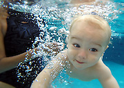 13-month-old Maddox Arnold learns breath control  while swimming on Wednesday. Karen Packer teaches water survival skills, to infants and children at her Collierville home. It provides them with the skills to help them save themselves in the event of a water accident.  Drowning is the 2nd leading cause of death amount children 1-19.