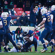 Army running back Raymond Maples, rush for loss of 4 yards to the ARMY 22, however Maple would fumble the ball and Navy Defensive end Jabaree Tuani #98 (Center) would recover the ball at ARMY 26 in the first quarter of the 112th version of this storied rivalry game between Army and Navy at Fed EX Field in Landover Md.Saturday, Dec. 10, 2011 at Fed EX field in Landover Md. .
