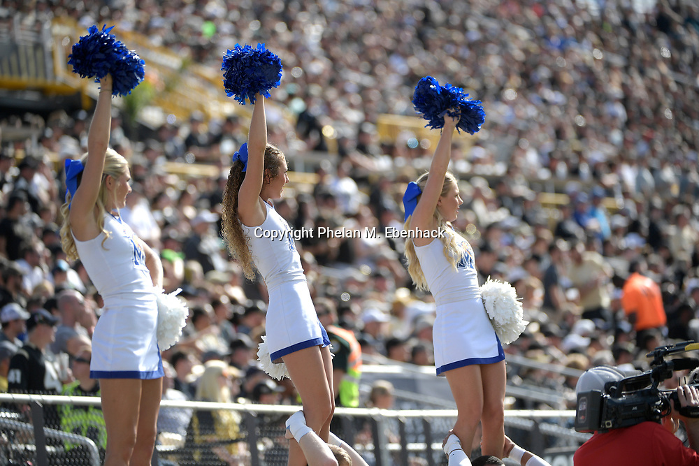 Memphis cheerleaders watch from the sideline during the first half of the American Athletic Conference championship NCAA college football game against Central Florida Saturday, Dec. 2, 2017, in Orlando, Fla. (Photo by Phelan M. Ebenhack)