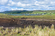 Turves cut from traditional turf peat bog for fuel have environmental impact, Dunvegan Loch, Isle of Skye, Western Scotland