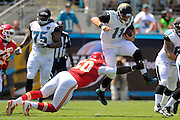 Jacksonville Jaguars quarterback Blaine Gabbert (11) leaps t tried to avoid a tackle by Kansas City Chiefs outside linebacker Justin Houston (50) during their game at EverBank Field on Sept. 8, 2013 in Jacksonville, Florida. <br /> <br /> ©2013 Scott A. Miller