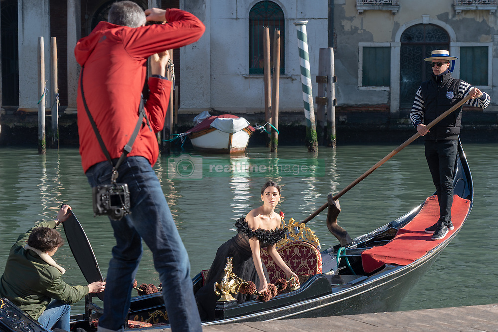 A model having her photo taken on a gondola in Venice. From a series of travel photos in Italy. Photo date: Tuesday, February 12, 2019. Photo credit should read: Richard Gray/EMPICS