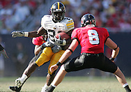 01 SEPTEMBER 2007: Iowa running back Albert Young (21) tries to avoid Northern Illinois strong safety Mark Reiter (8) in Iowa's 16-3 win over Northern Illinois at Soldiers Field in Chicago, Illinois on September 1, 2007.