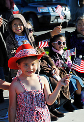 Five year-old Angel Castro from Salinas gets into the patriotic spirit at Sunday's well-attended 2nd Annual Monterey County Veteran's Day Parade.