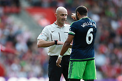 Swansea City's Ashley Williams has words with Referee Roger East - Mandatory by-line: Jason Brown/JMP - 07966 386802 - 26/09/2015 - FOOTBALL - Southampton, St Mary's Stadium - Southampton v Swansea City - Barclays Premier League