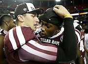 ATLANTA, GA - DECEMBER 31:  Quarterback Johnny Manziel #2 of the Texas A&M Aggies embraces defensive back De'Vante Harris #1 after the Chick-fil-A Bowl game against the Duke Blue Devils at the Georgia Dome on December 31, 2013 in Atlanta, Georgia.  (Photo by Mike Zarrilli/Getty Images)