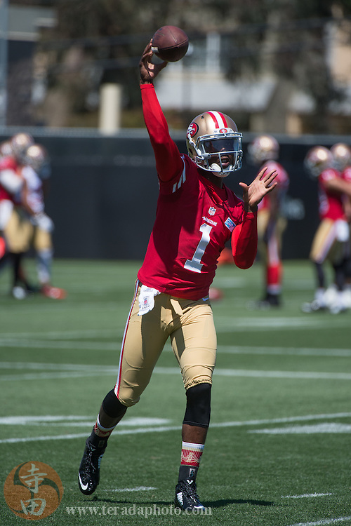 July 24, 2014; Santa Clara, CA, USA; San Francisco 49ers quarterback Josh Johnson (1) throws the football during training camp at the SAP Performance Facility.