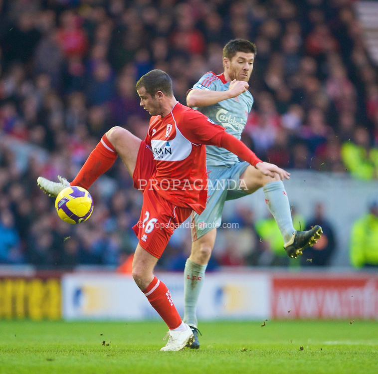 MIDDLESBROUGH, ENGLAND - Saturday, February 28, 2009: Liverpool's Xabi Alonso and Middlesbrough's Matthew Bates during the Premiership match at the Riverside Stadium. (Photo by David Rawcliffe/Propaganda)