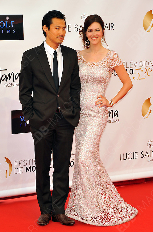 10.JUNE.2012. MONACO<br /> <br /> FREDERIC CHAU AND SANDRA LOU ATTEND THE OPENING CEREMONY OF THE 52ND MONTE CARLO TELEVISION FESTIVAL HELD AT THE GRAMALDI FORUM.  <br /> <br /> BYLINE: EDBIMAGEARCHIVE.CO.UK<br /> <br /> *THIS IMAGE IS STRICTLY FOR UK NEWSPAPERS AND MAGAZINES ONLY*<br /> *FOR WORLD WIDE SALES AND WEB USE PLEASE CONTACT EDBIMAGEARCHIVE - 0208 954 5968*