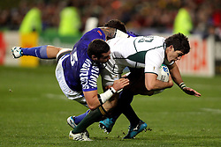 © Andrew Fosker / Seconds Left Images 2011 - South Africa's Jaque Fourie is taken out by a double tackle from Samoa's Kane Thompson  (L) &  Mahonri Schwalger  South Africa v Samoa - Rugby World Cup 2011 - North Harbour Stadium - Auckland - New Zealand - 30/09/2011 -  All rights reserved..