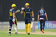 Rilee Rossouw and James Fuller of Hampshire during the Royal London One Day Cup match between Hampshire County Cricket Club and Middlesex County Cricket Club at the Ageas Bowl, Southampton, United Kingdom on 23 April 2019.