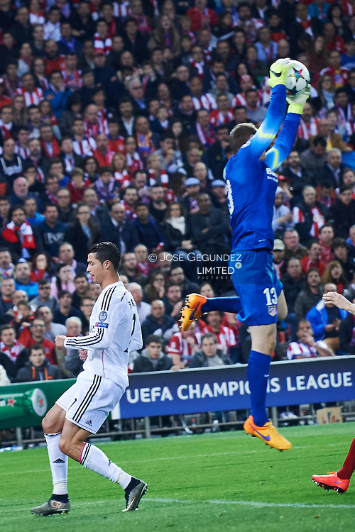 Cristiano Ronaldo (Real Madrid F.C.) and Oblak in action during the Champions League, round of 4 match between Atletico de Madrid and Real Madrid at Estadio Vicente Calderon on April 14, 2015 in Madrid, Spain