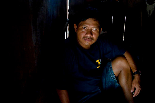 "Ricardo Etsam, member of a awajun community, who was wounded during the Bagua facts posses for a portrait at his house near to Imaza river-port of the Mara-on river in Amazons district, Peru. After the events of June 5 in the Amazonian province of Bagua, in northeastern Peru, where 24 policemen and a number still not confirmed of natives from the communities of the ÒAlto Mara-onÓ and civilians died in clashes after a series of demonstrations in opposition to the approval by the Peruvian government, for a group of ordinances that allow large flexibility in the restrictions on resource extraction in the area, breaking the 169 agreement of ILO (International Labour Organization), which requires the consultation of indigenous communities about the exploitation of nature in their territories. One of the most active communities was the awajun, a warlike and revengeful people, heritors of the Jibaros and recently contacted near to 1950. For the leader or ""apu"" for one of the aguarunas riverside communities of the Mara-on, Simon Weepiu, Òthe force of this movement come from the conviction of the struggle, which is caused by the ancestral development as based on worldview, which provides the native of a special power, that of becoming one with his idea and his brothers, to focus all on the same objective and be just a great strength."" The government aims to generate development in the area allowing the exploitation of property, The jungle is rich in gold and oil, and even argue that natural wealth of the region belong to all Peruvians, and not just the communities that inhabit it, but acts as the oil«s filtration to waters of the Mara-on, left in evidence that in a complex ecosystem like jungle that mixed spilled oil by rain in the river, home to fishes, as well as the waters that irrigate cassava, bananas, sugarcane and other elements vital to the development of communities. The natives, insist that the forest is not only home, is where they get medicines to cure their sick"