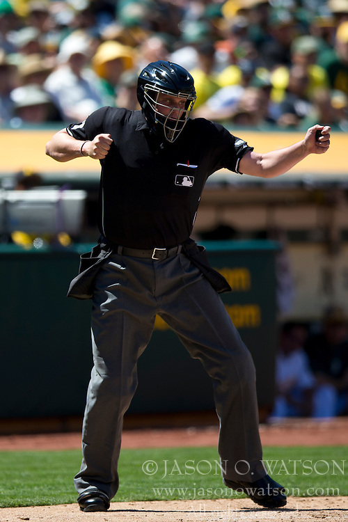 OAKLAND, CA - MAY 26:  MLB umpire Jordan Baker #71 calls a third strike against Miguel Cabrera #24 of the Detroit Tigers (not pictured) during the sixth inning against the Oakland Athletics at O.co Coliseum on May 26, 2014 in Oakland, California. The Oakland Athletics defeated the Detroit Tigers 10-0.  (Photo by Jason O. Watson/Getty Images) *** Local Caption *** Jordan Baker