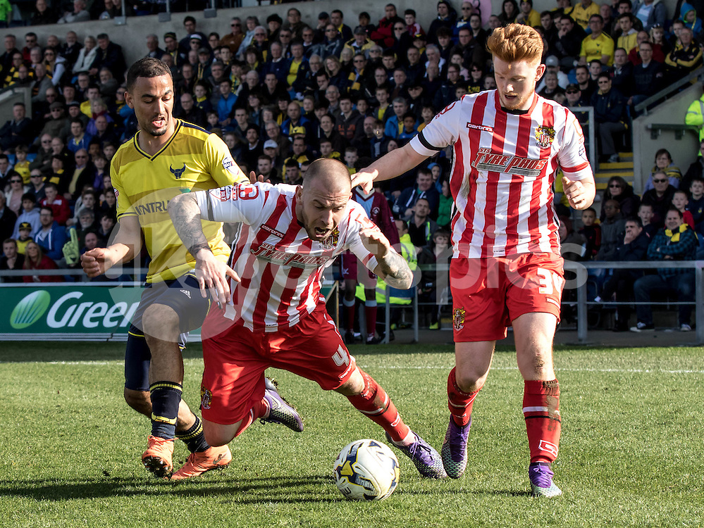 Keith Keane of Stevenage is fouled by Kemar Roofe of Oxford United during the Sky Bet League 2 match between Oxford United and Stevenage at the Kassam Stadium, Oxford, England on the 25th March 2016. Photo by Liam McAvoy.