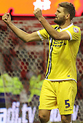 Jos Hooiveld celebrates after the full time whistle of the Sky Bet Championship match between Nottingham Forest and Millwall at the City Ground, Nottingham, England on 31 January 2015. Photo by Jodie Minter.