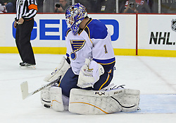 Feb 9; Newark, NJ, USA; St. Louis Blues goalie Brian Elliott (1) makes a save during the second period at the Prudential Center.