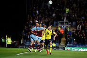 Pablo Zabaleta (5) of West Ham United heads the ball clear from Anthony Forde (14) of Oxford United during the EFL Cup match between Oxford United and West Ham United at the Kassam Stadium, Oxford, England on 25 September 2019.