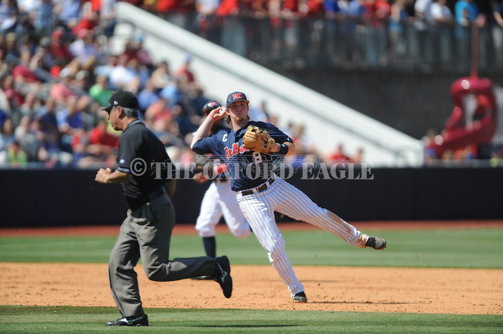 Mississippi's Austin Anderson throws to first for an out vs. LSU at Oxford-University Stadium in Oxford, Miss. on Saturday, April 19, 2014. (AP Photo/Oxford Eagle, Bruce Newman)
