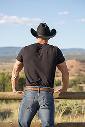back of a cowboy on a ranch
