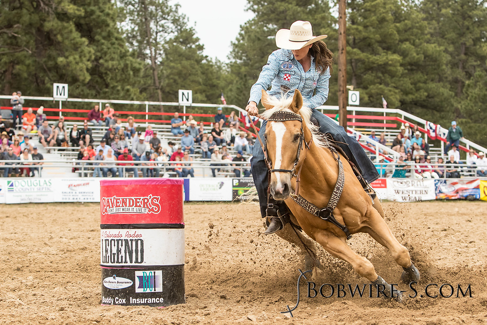 Brittany Pozzi-Tonozzi makes her barrel racing run during the third performance of the Elizabeth Stampede on Sunday, June 3, 2018.