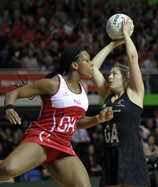 England's Eboni Beckford-Chambers charges New Zealand's Anna Thompson during a New World Netball Series match, Trusts Stadium, Auckland, New Zealand, Monday, October 03, 2011.  Credit:SNPA / David Rowland