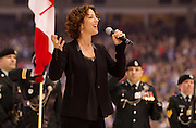 VANCOUVER, BC - MARCH 2:  Sarah McLachland sings the Canadian national anthem before the 2014 Tim Hortons Heritage Classic game between the Ottawa Senators and the Vancouver Canucks at BC Place on March 2, 2014 in Vancouver, B.C., Canada.  (Photo by Kevin Light/NHLI via Getty Images)