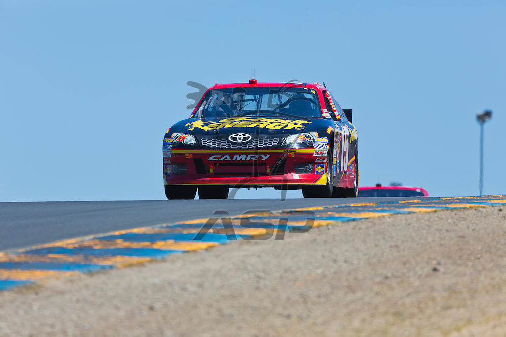 SONOMA, CA - JUN 24, 2012: Clint Bowyer (15) brings his car through the turns during the Toyota Save Mart 350 at the Raceway at Sonoma in Sonoma, CA.