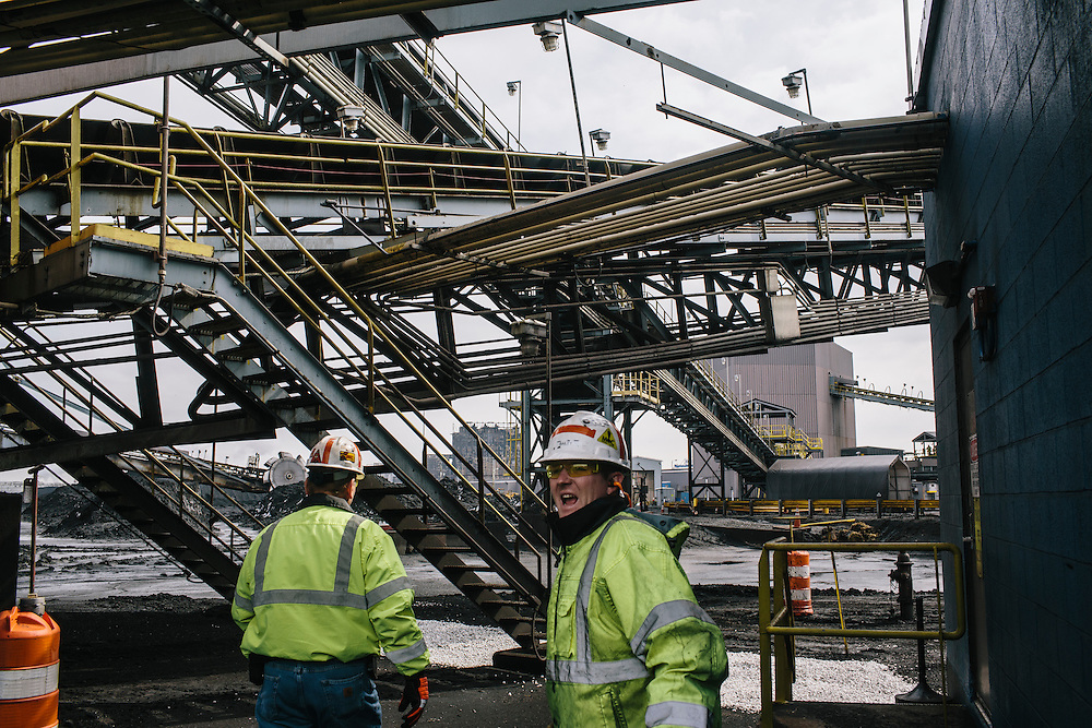Al Meckel, left, manager of operations and Chris Bailey, right, safety supervisor, head to the top of the silo at Consol Energy's Baltimore Terminal on March 6, 2014. The silo can hold 2,000 tons of coal in addition to the rest of the 30 acres of storage.