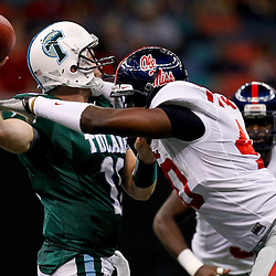 Sep 11, 2010; New Orleans, LA, USA;Mississippi Rebels defensive end Kentrell Lockett (40) sacks Tulane Green Wave quarterback Ryan Griffin (11) during the first half at the Louisiana Superdome.  Mandatory Credit: Derick E. Hingle