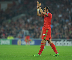 Gareth Bale of Wales (Real Madrid) claps the home support. - Photo mandatory by-line: Alex James/JMP - Mobile: 07966 386802 - 12/06/2015 - SPORT - Football - Cardiff - Cardiff City Stadium - Wales v Belgium - Euro 2016 qualifier