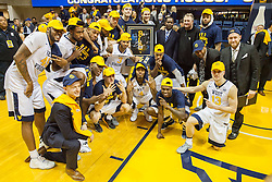 Dec 17, 2016; Morgantown, WV, USA; West Virginia Mountaineers head coach Bob Huggins and his players pose for a photo during the celebration of 800 career wins at WVU Coliseum. Mandatory Credit: Ben Queen-USA TODAY Sports