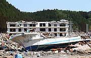 May 18, 2011; Minamisanriku, Miyagi Pref., Japan - A car sits on top of a three-story apartment complex and a damaged fishing boat sits idle among the debris in Minamisanriku after the magnitude 9.0 Great East Japan Earthquake and Tsunami that devastated the Tohoku region of Japan on March 11, 2011.