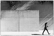 Woman walking past Queensland Art Gallery, Brisbane, Australia