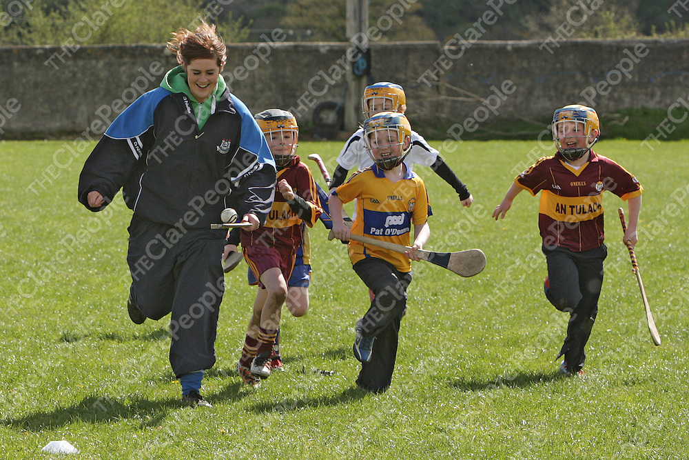 Coach Marie Halpin goes on a solo as her group give chase at the Tulla Easter Camp.<br /> Photograph by Flann Howard