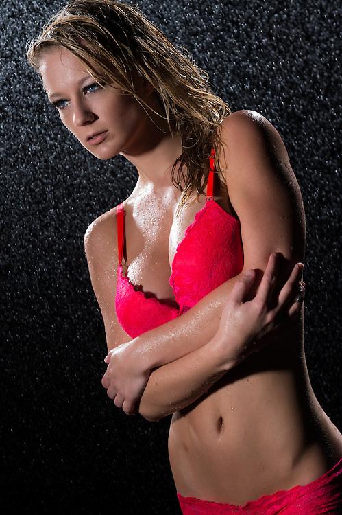 Looking away seductive wet woman in red bra and underwear