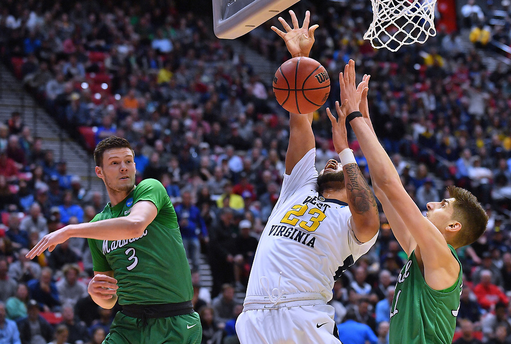 SAN DIEGO, CA - MARCH 18:  West Virginia Mountaineers forward Esa Ahmad (23) is fouled by Marshall Thundering Herd forward Ajdin Penava (11) during a second round game of the Men's NCAA Basketball Tournament at Viejas Arena in San Diego, California.  (Photo by Sam Wasson)