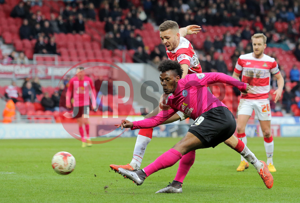 Shaquile Coulthirst of Peterborough United gets a shot on goal while under pressure from Aaron Taylor-Sinclair of Doncaster Rovers - Mandatory byline: Joe Dent/JMP - 19/03/2016 - FOOTBALL - The Keepmoat Stadium - Doncaster, England - Doncaster Rovers v Peterborough United - Sky Bet League One