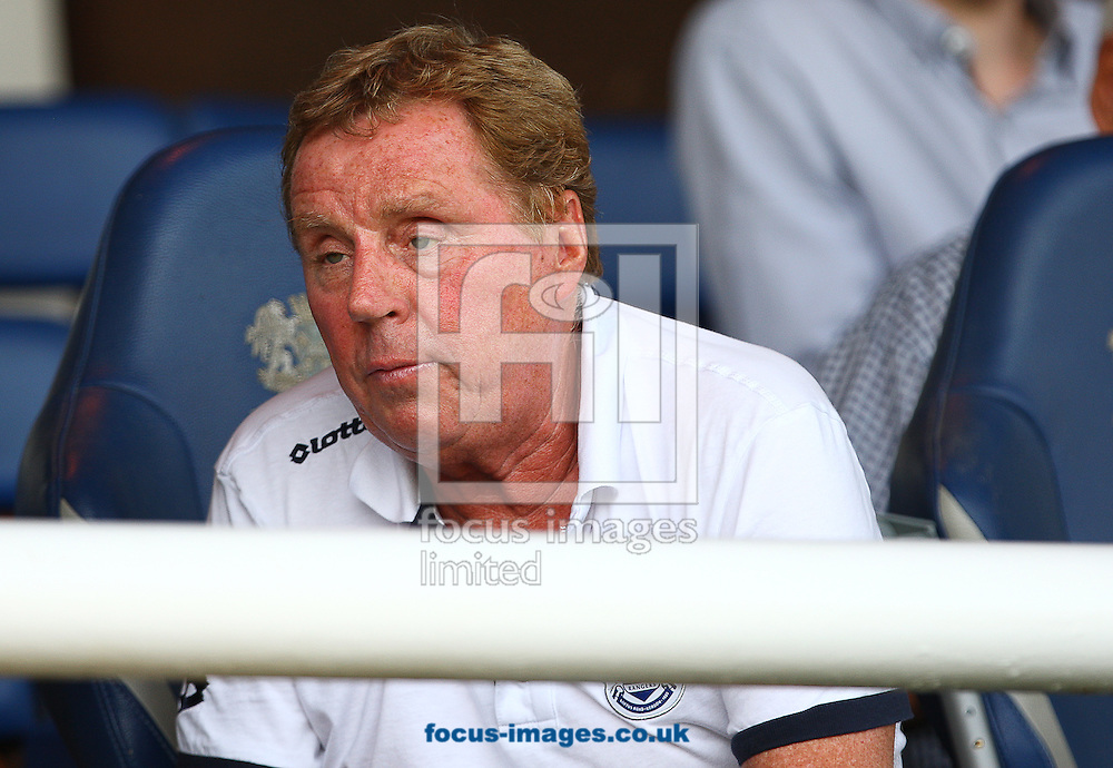 Picture by Rob Fisher/Focus Images Ltd +44 7450 945824<br /> 13/07/2013<br /> Harry Redknapp, manager of Queens Park Rangers arrives on crutches during the pre season friendly match at London Road, Peterborough.