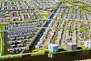 Nederland, Flevoland, Almere, 07-05-2015;  Almere-Buiten, Eilandenbuurt eengezinswoningen en stadsvilla's omgeven door waterpartijen.<br /> Eilandenbuurt (Island Area), town houses and urban villas surrounded by water.<br /> luchtfoto (toeslag op standard tarieven);<br /> aerial photo (additional fee required);<br /> copyright foto/photo Siebe Swart