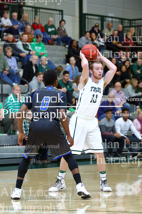 07 December 2016:  Nick Coleman defended by T.J. Cobbs during an NCAA men's division 3 CCIW basketball game between the North Park Vikings and the Illinois Wesleyan Titans in Shirk Center, Bloomington IL