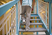 A prisoner climbs the stairs on E wing. HMP Wandsworth, London, United Kingdom