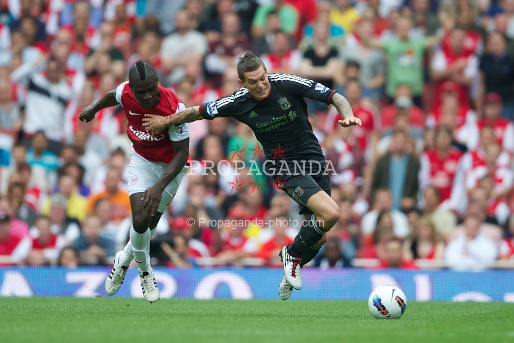 LONDON, ENGLAND - Saturday, August 20, 2011: Liverpool's Daniel Agger in action against Arsenal's Emmanuel Frimpong during the Premiership match at the Emirates Stadium. (Pic by David Rawcliffe/Propaganda)