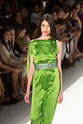 Bright green gown with asymmetrical shoulder draping and a turquoise and silver belt. By Carlos Miele at the Spring 2013 Mercedes-Benz Fashion Week in New York.