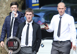 Manchester UK 24.07.2017:Liverpool fans appear in court after violence at  Manchester United game in   September 2016<br /> <br /> <br /> <br /> Pictured  Carl Irvine White shirt with Phone in has hand<br /> Ian Mullen- Black Jacket Grey tie white shirt,<br /> Joe Macdonald blue Jacket drinking out of bottle